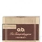 Bild på en tidigare version av o.b. tampong förpackning. Gul- och brunfärgad med ränder.